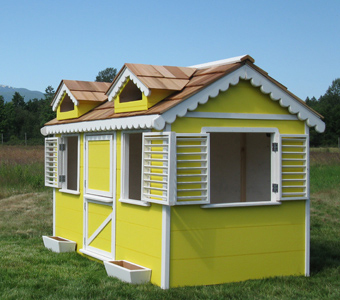 Little Cedar Cottage painted yellow. Beautiful playhouse