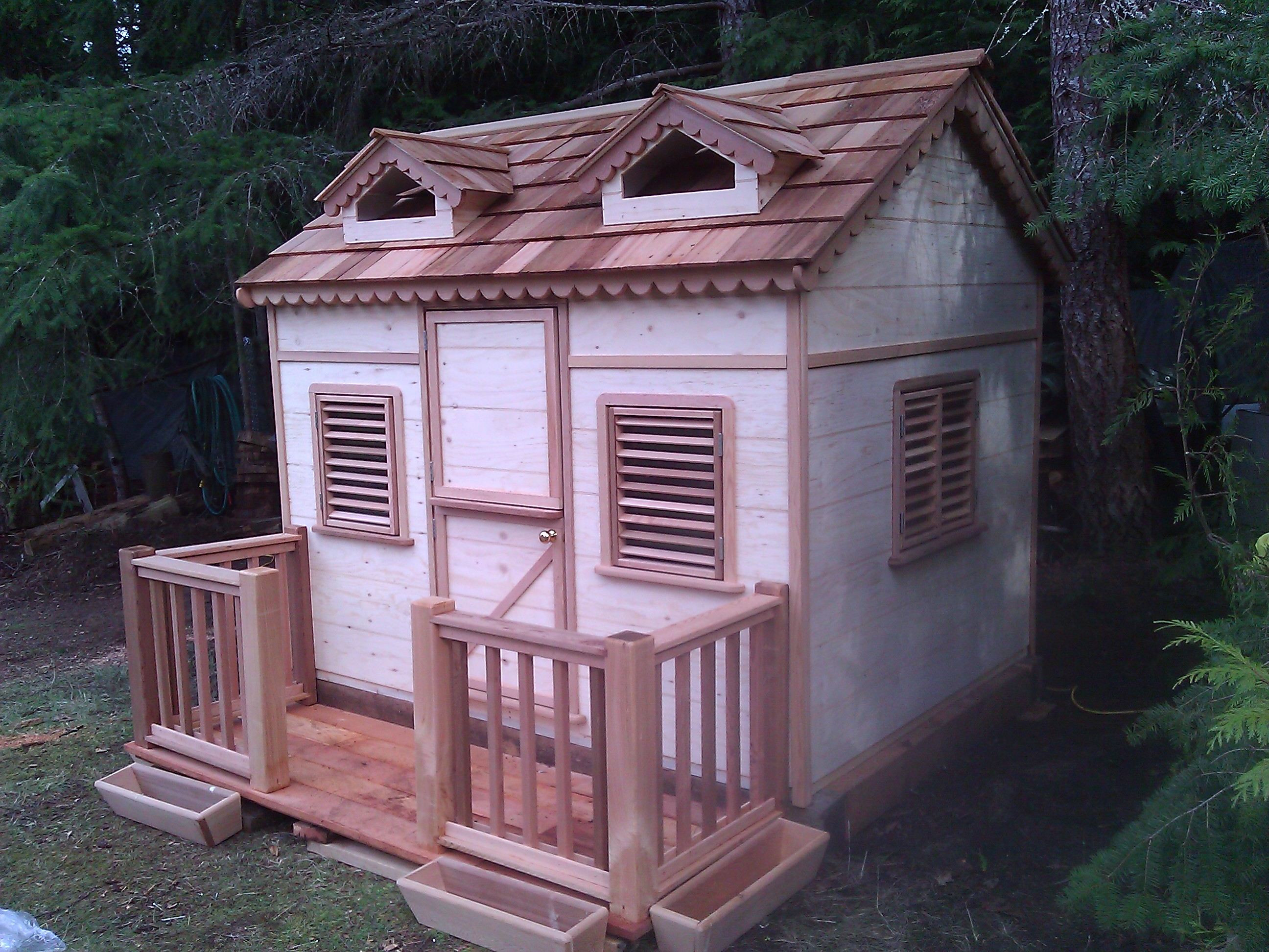 Cedar play houses wooden children playhouses build a for Childrens wooden playhouse kits