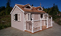 An Taupe shadow playhouse with front deck